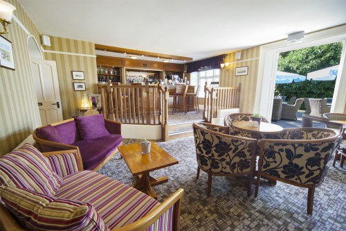 Enjoy a drink at the bar at Heacham Manor