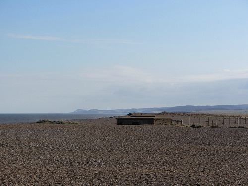 Cley beach with a half buried pill box!