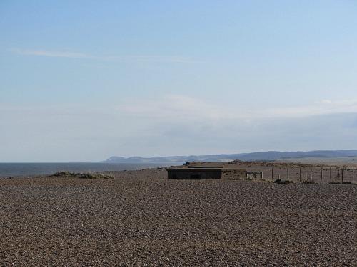 Cley beach with a half buried pill box!