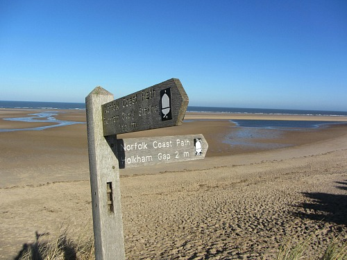 Waymarker for the Norfolk Coast Path in the sand dunes at Gun Hill
