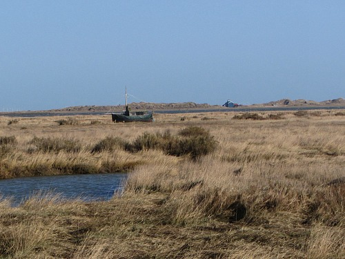 The Old Lifeboat Station on Blakeney Point in the distance