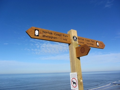 Norfolk Coast Path signs on the cliff tops between Sheringham and Cromer