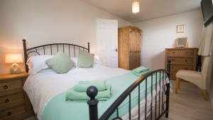 The bedroom in one of the Barton chalets
