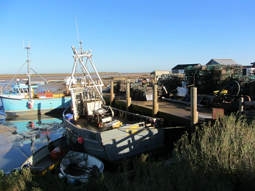 The working fishing harbour at Brancaster Staithe Norfolk
