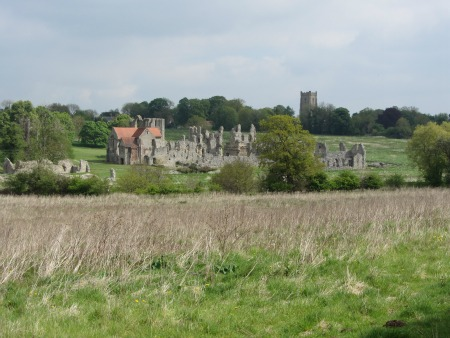 Distant view of Castle Acre Priory ruins