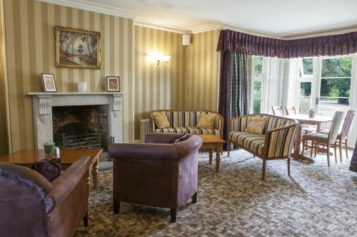 Relax in the drawing room at Heacham Manor