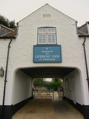 The original arch way at The Lifeboat Inn for horse drawn carriages