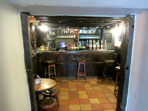 The oak carved bar at the Lifeboat Inn