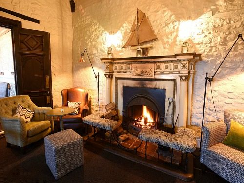 The welcoming fireplace in the lobby at The Lifeboat Inn, Thornham