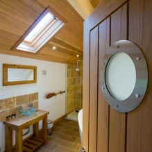 The detail of the porthole on the bathroom