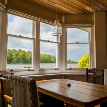 The stunning view over Ormesby Broad through the bay windows