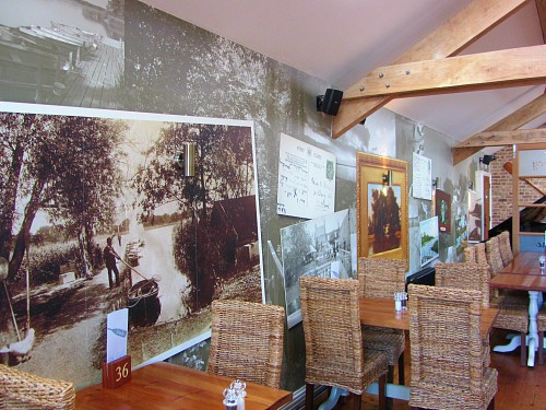 The restaurant with unique wallpaper depicting historic times at The Boathouse