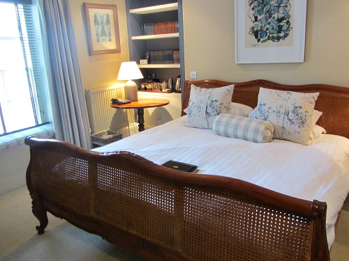 A bedroom overlooking the green at The Crown