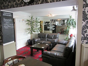 Relax on the comfy sofas in the Lobster Inn