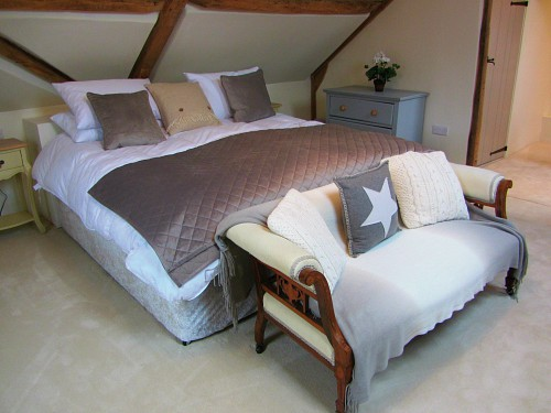 The sumptuous bedroom in The Loft, Hingham, Norfolk