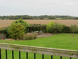 Big Sky Cottages garden looking towards Winterton sand dunes, Norfolk