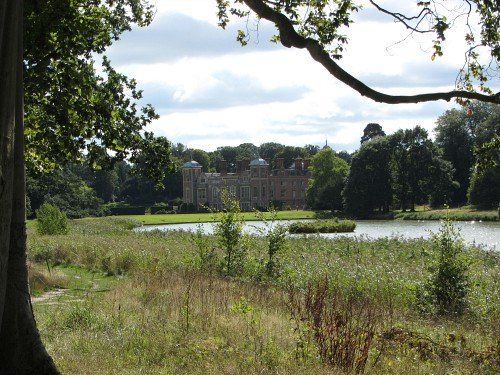 View of Blickling Hall from the lake in the grounds of this magnificent stately home in Norfolk