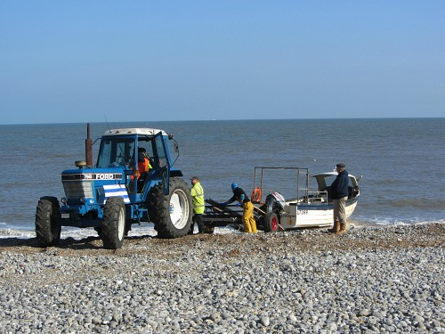The fishermen coming onto Cromer beach