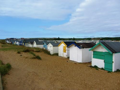 The beach huts behind the promenade at Heacham