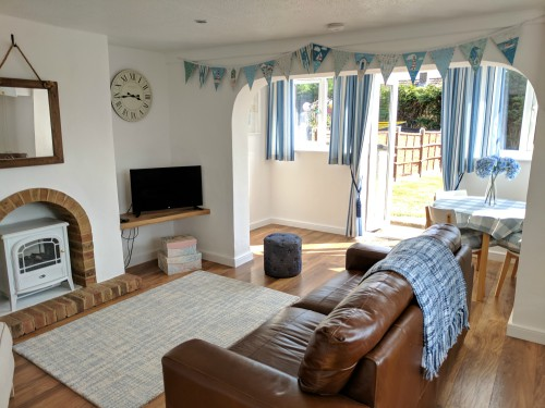 The light and airy sitting room leading out to the secure garden