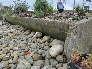 The old feeding troughs used as flower beds