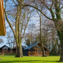 The lodges in the garden of The Boathouse
