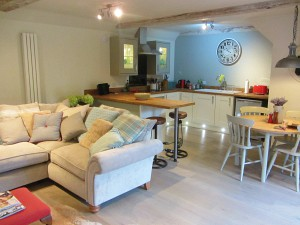 The open plan sitting room and kitchen at The Loft, Hingham, Norfolk
